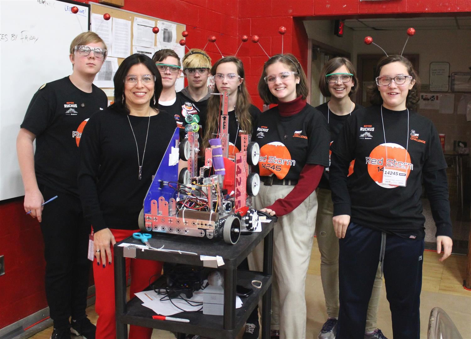 Red Hook Junior Varsity Robotics team poses with its robot.